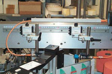 drylin® T rail guide in label feed system for packaging machine